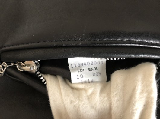 image of tag inside the front breast pocket