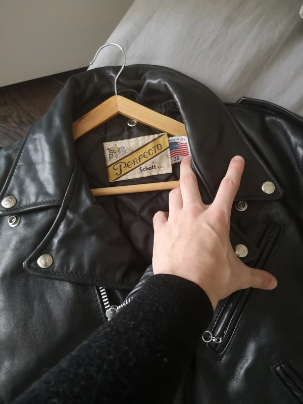 Perfecto leather jacket on a coat hanger.