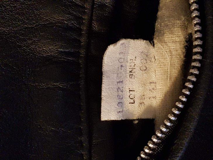 Inner label 141  - reads 1082104013 (?) LOT 38, BNDL 002, 141
