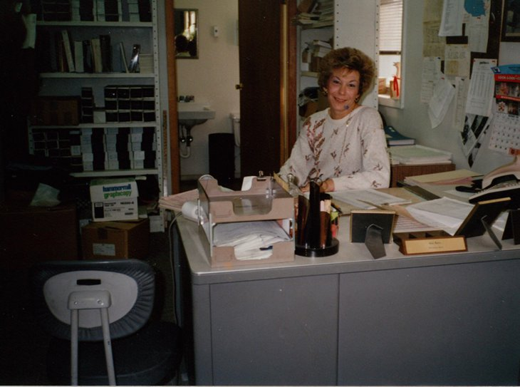 Gail Hawkins behind her desk in the 1980's